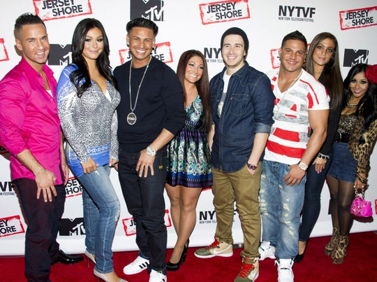 "FILE - This Oct. 24, 2012, file photo shows ""Jersey Shore"" cast members, from left, Mike ""The Situation"" Sorrentino, Jenni ""JWoww"" Farley, Paul ""Pauly D"" Delvecchio, Deena Cortese, Vinny Guadagnino, Ronnie Ortiz-Magro, Sammi ""Sweetheart"" Giancola and Nicole ""Snooki"" Polizzi at a panel entitled ""Love, Loss, (Gym, Tan) and Laundry: A Farewell to the Jersey Shore"" in New York. MTV announced that most of the original cast would return to the network for ""Jersey Shore Family Vacation,"" a relaunch of the series set to debut in 2018. (Photo by Charles Sykes/Invision/AP, File) ORG XMIT: PAPM102"