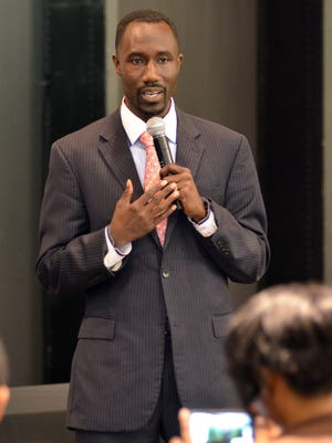 Jackson Mayoral candidate Tony Yarber talks with local business people before speaking Tuesday at the Mississippi Minority Business Alliance at Metrocenter mall in Jackson. RICK GUY/THE CLARION-LEDGER