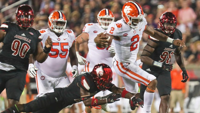Clemson's Kelly Bryant scrambles for yardage in the first  as the Tigers led the Cards at halftime.