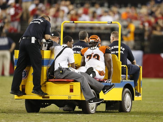 Cincinnati Bengals guard Trey Hopkins (73) is carted off the field against the Arizona Cardinals during their preseason game at the University of Phoenix Stadium.