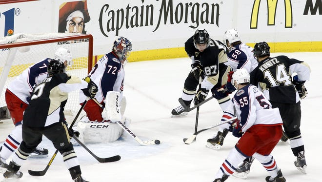 Columbus Blue Jackets goalie Sergei Bobrovsky (72) makes a save against Pittsburgh Penguins center Sidney Crosby (87) during the first overtime in game two of the first round of the 2014 Stanley Cup Playoffs.