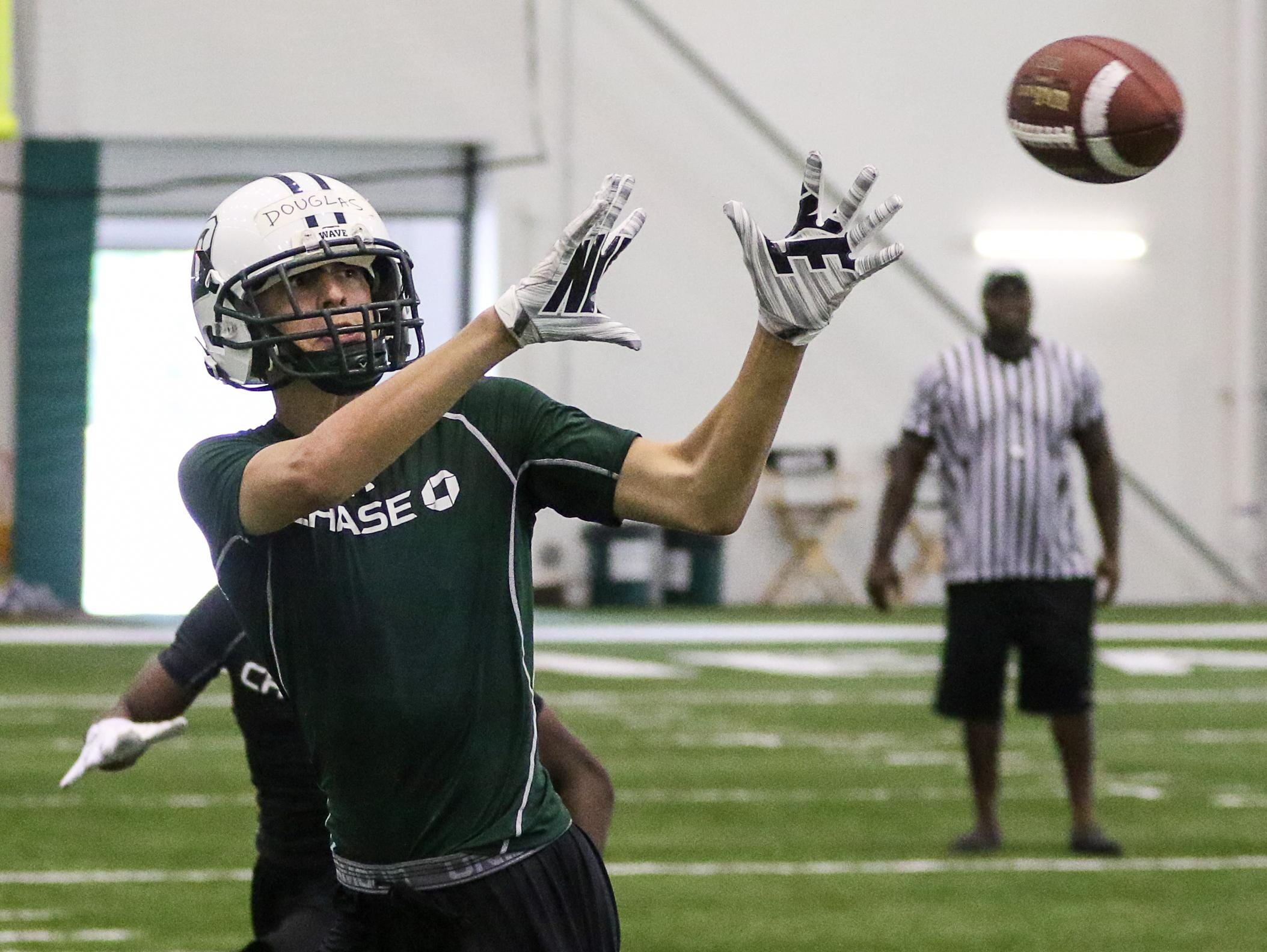Delbarton's Matt Douglas catches a pass in the New York Jets 7-On-7 Tournament at the Atlantic Health Jets Training Center in Florham Park on June 12, 2015.
