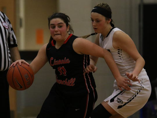 Alivia Kondrath drives hard to the basket Friday night against Plymouth.