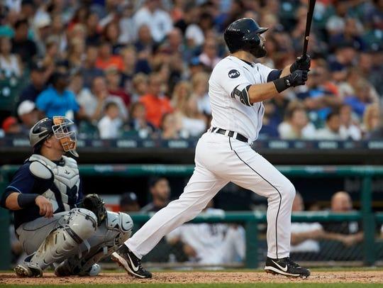 Tigers first baseman Alex Avila (31) hits a home run
