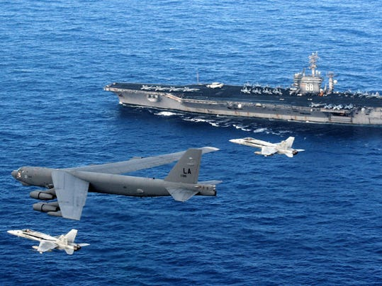Coordinating the combat power of an Air Force B-52 bomber with the Navy's carrier strike groups is a key element