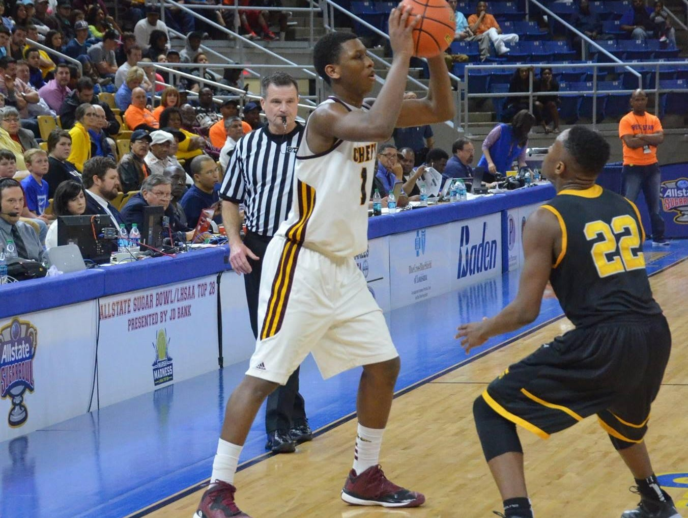 Natchitoches Central forward Brandon Rachal (1, left) is guarded by Scotlandville's Jordan Adebutu during the LHSAA Class 5A Finals in March. Rachal and Adebutu are playing for Elfrid Payton Elite this summer.