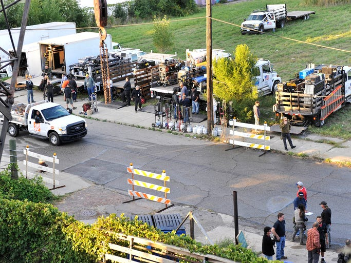 "Trucks of gear and crew members set up along Hastings are part of a movie film scene, presumably ""Batman v. Superman,"" shot on East Milwaukee and Hastings."
