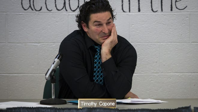 Timothy Capone, chief school adminstrator, listens during the public comment portion of a meeting of the Montague school board meeting in February. The board approved an extension of his contract Monday.