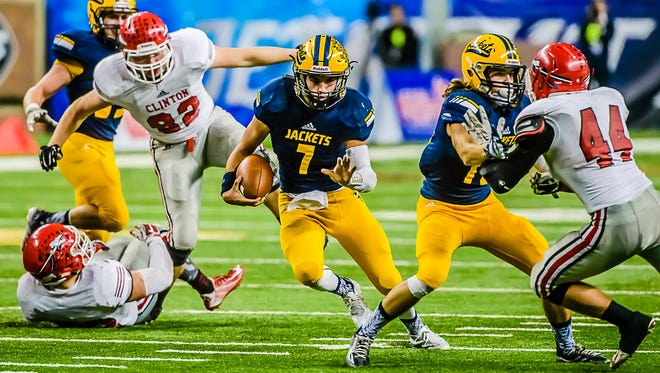 Ithaca quarterback Jake Smith, 7, runs for a 1st down to the Clinton 23 yardline late in the 3rd quarter Friday.