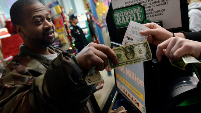 In this file photo, Marcus Mitchell of York City purchases several lottery tickets at Bob's West End News, 639 W. Market St. (John A. Pavoncello - jpavoncello@yorkdispatch.com)