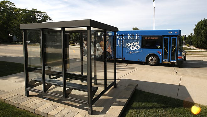 A Fond du Lac Transit bus drives by a bus shelter Tuesday August 15, 2017 on Division Street. Doug Raflik/USA TODAY NETWORK-Wisconsin