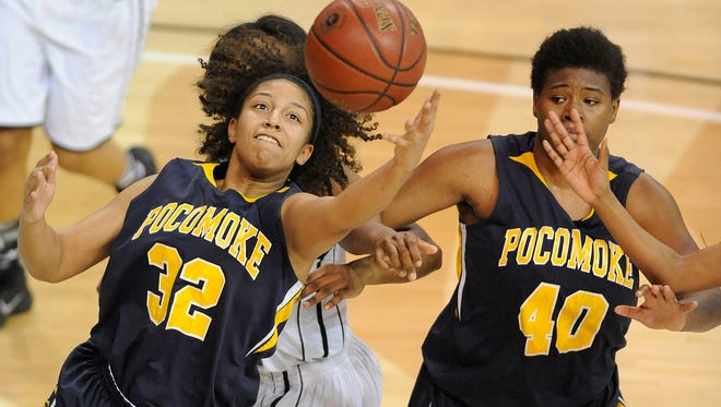 Pocomoke's Anissa Jones, left, grabs a loose ball near teammate Dynaisha Christian in the first half of a Class 1A state semifinal girls' basketball game against Forestville at SECU Arena in Towson on Wednesday, March 11. Pocomoke lost 63-47.