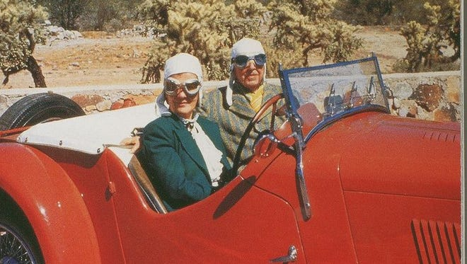 Frank Lloyd Wright, with wife Olgivanna, at the wheel of a 1937 AC Sports Car, which is being restored for a show featuring vehicles he owned.