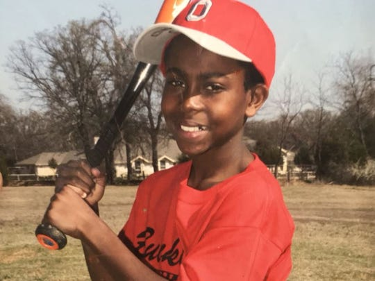 Josh Jackson is shown in Texas as a young baseball player. He threw a no-hitter when he was in fifth grade.