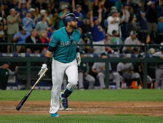 Nelson Cruz watches his 300th career home run leave