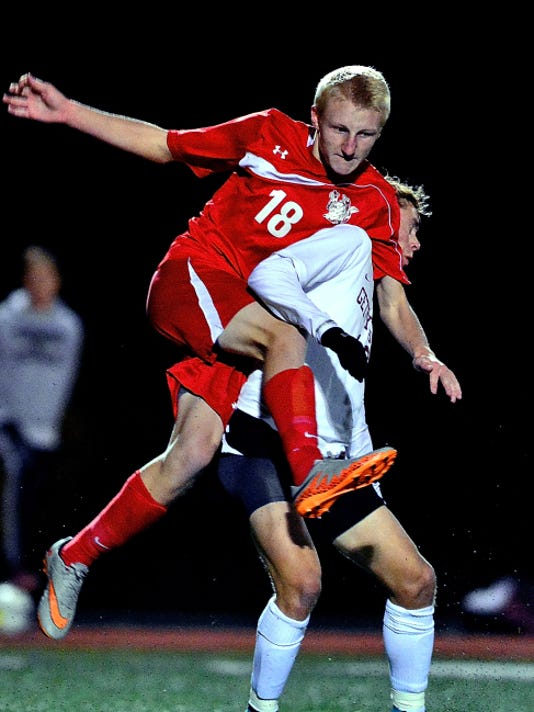 Susquehannock's Jason Weger, left, and Gettysburg's Adam Yingling (10) get tangled up during the District 3-AA boys' soccer semifinals at Northeastern on Monday.