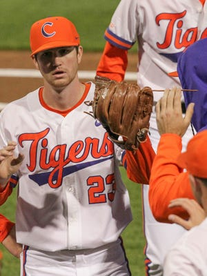 Clemson pitcher Charlie Barnes (23) is greeted by teammates after getting South Carolina out of the top of the first inning on March 3 at Doug Kingsmore Stadium in Clemson.