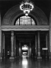 Michigan Central Station, also known as the Amtrak Train Station in Detroit in April 1982. Ford Motor company is looking for the lighting  fixtures that ere in the station.