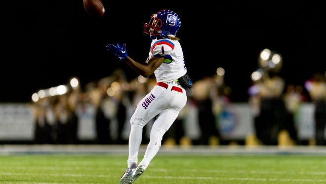 Former Cleveland and current Blackman wide receiver Micaleous Elder makes a catch during a 2017 game. Elder committed to MTSU Saturday.