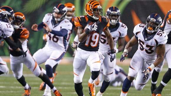 Cincinnati Bengals wide receiver Brandon Tate (19) returns a punt for a big gain against the Denver Broncos during the fourth quarter of their game played at Paul Brown Stadium in Cincinnati, Ohio Monday December  22, 2014.