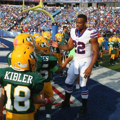 Fred Jackson greets youth football players during halftime