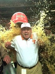 Tennessee coach Phil Fulmer gets doused with Gatorade following the Volunteers 24-14 win over Mississippi State in the SEC Championship game at the Georgia Dome in Atlanta on Saturday, Dec. 5, 1998.