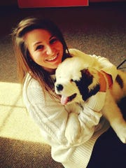 Jenna Intersimone with a St. Bernard puppy.