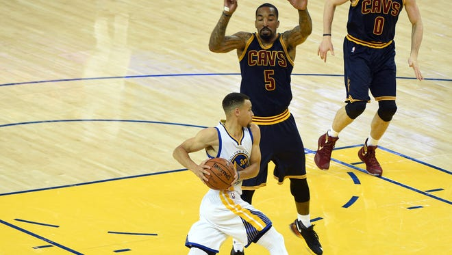 Golden State Warriors guard Stephen Curry (30) drives to the basket against Cleveland Cavaliers guard J.R. Smith (5) during the third quarter in Game 1.