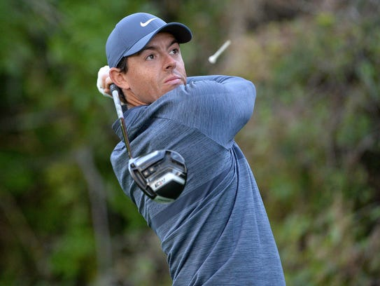 Rory McIlroy plays his shot from the 12th tee during