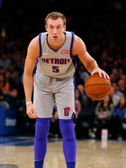 Pistons guard Luke Kennard dribbles the ball against
