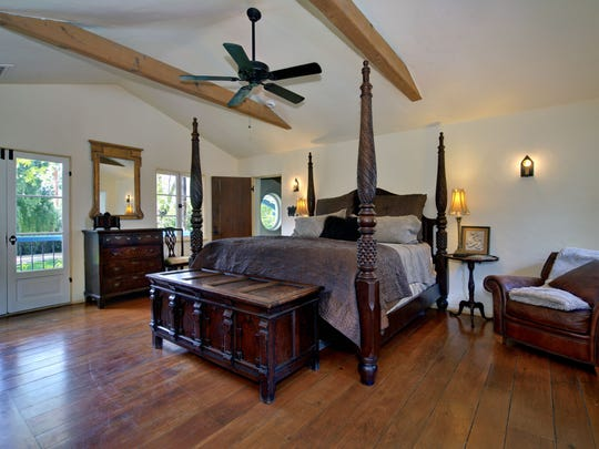 One of the house's six bedrooms. Each features a four-poster bed.