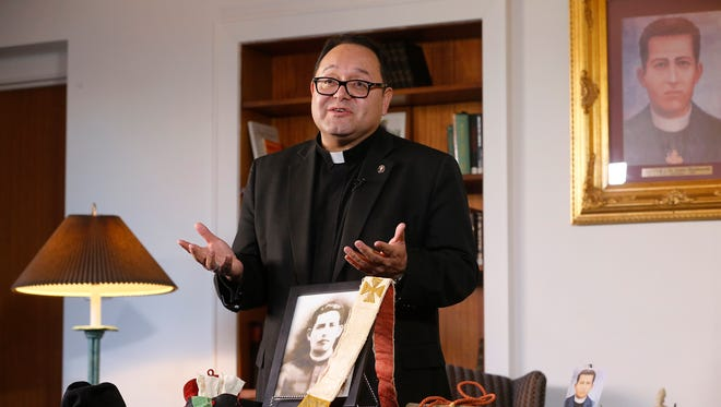 The Rev. Fabian Marquez of the Diocese of El Paso talks about the week of activities scheduled for the celebration of the 100th anniversary of the ordination of St. Pedro de Jesus Maldonado that are being held at St. Patrick Cathedral beginning Monday and running through Friday. Relics that belonged to the saint that were loaned to the diocese by his family for display during the week sit in front of Marquez.