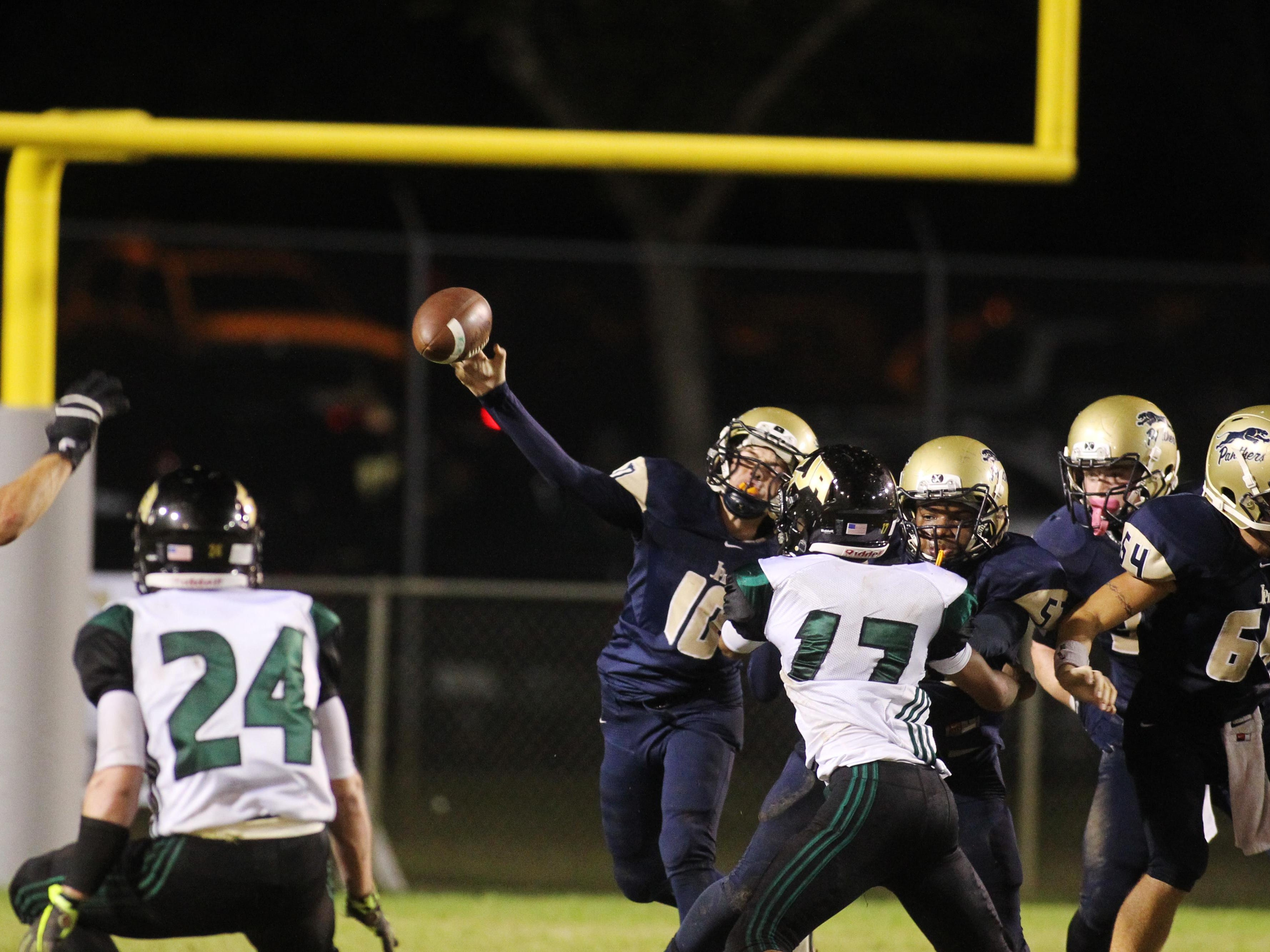 John Paul II quarterback Brian Woodend makes a pass in the championship game of the North Florida Football Conference at Gene Cox Stadium.