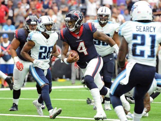 Houston Texans quarterback Deshaun Watson (4) runs for a touchdown against the Tennessee Titans during the first half of an NFL football game, Sunday, Oct. 1, 2017, in Houston. (AP Photo/George Bridges)