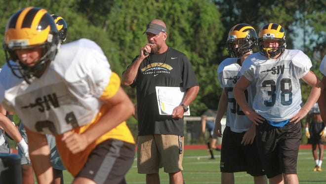St. John Vianney's Derek Sininsky watches his players work out during a practice last month.