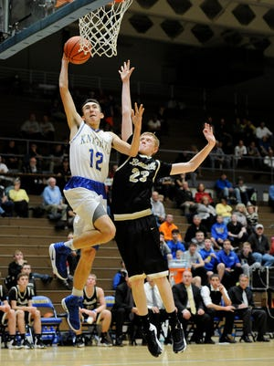 Castle's Alex Hemenway (12) attempts a basket against Boonville's Hunter Bruce (23) during their game at Castle High School in Newburgh, Tuesday, Nov. 29, 2016. Castle beat Boonville 106-43.
