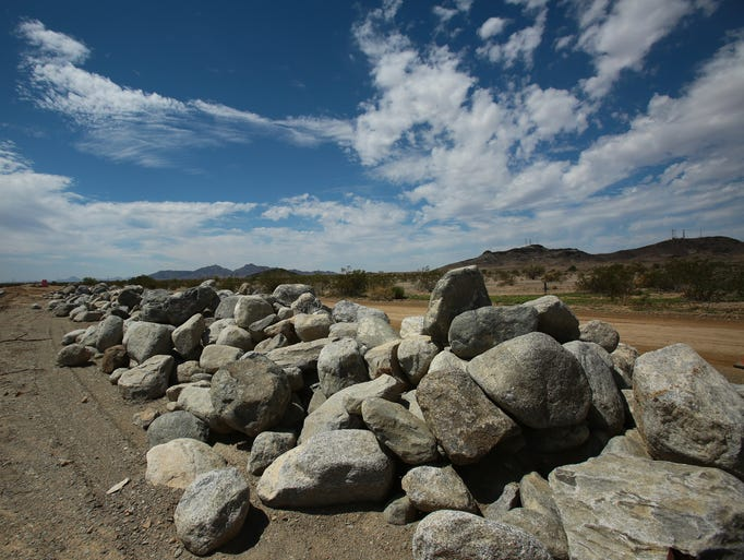 Rocks are positioned to provide edge protection for water flow from nearby mountains at the McCoy solar project near Blythe, Calif. on Wednesday, August 20, 2014. The project is currently creating roads to enable more workers to begin future aspects of the project's construction.