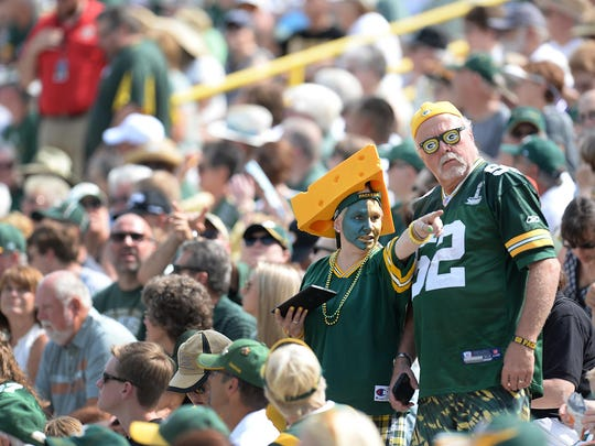 Green Bay Packers shareholders dress for the full stadium experience during an annual meeting at Lambeau Field.