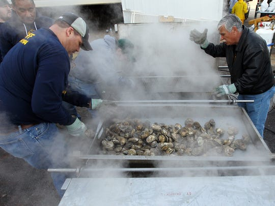Batches of steamed oysters come out at the St. George Oyster Roast in Anderson.