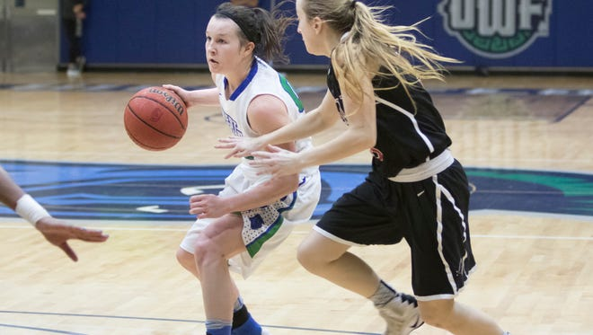 Alex Coyne (00) brings the ball up court during the basketball game against Christian Brothers University at the University of West Florida in Pensacola on Tuesday, February 28, 2017.