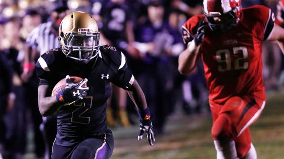 Male's  Ellis Cain breaks for a huge run and the go ahead touchdown late in the 4th quarter against Manual.  Oct. 24, 2014