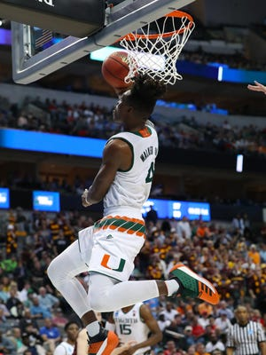 Mar 15, 2018: Miami (Fl) Hurricanes guard Lonnie Walker IV (4) shoots a reverse lay-up against Loyola (Il) Ramblers during the game against the in the first round of the 2018 NCAA Tournament at American Airlines Center.