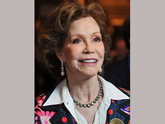 """FILE - This Jan. 8, 2012 file photo shows actress Mary Tyler Moore at the taping of """"Betty White's 90th Birthday: A Tribute To America's Golden Girl"""" in Los Angeles. Moore died Wednesday, Jan. 25, 2017, at age 80. (AP Photo/Vince Bucci, File)"""