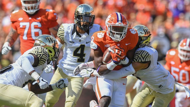 Clemson running back Travis Etienne (9) carries against Wake Forest during the 1st quarter on Saturday, October 7, 2017 at Clemson's Memorial Stadium.