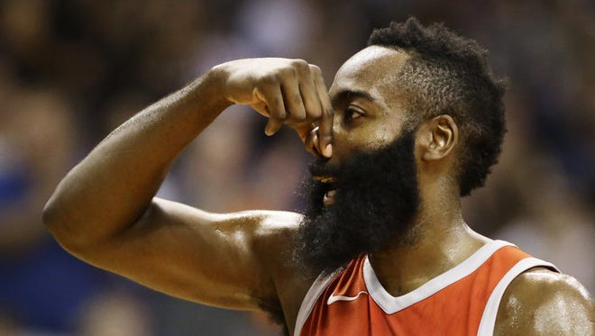 Houston Rockets James Harden pinches his nose against the Phoenix Suns in the first half on Nov. 16, 2017 at Taking Stick Resort Arena in Phoenix, Ariz. The Rockets scored 90 points in the half.