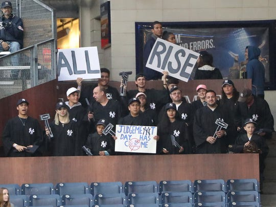 "Fans seated in the right field fan section named ""The Judges Chambers"" for New York Yankees right fielder Aaron Judge (not pictured) wear judges robes during the game against the Kansas City Royals at Yankee Stadium."