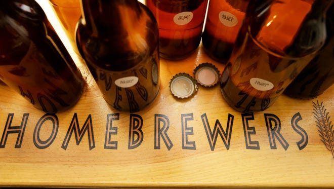 Bottles of home brew being tasted at the Arizona Society of Homebrewers monthly meeting on Oct. 18, 2016 in Scottsdale, Ariz.