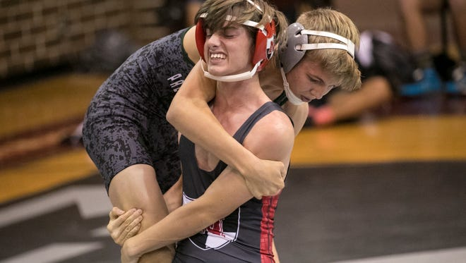 Ben McCallister of Palmetto Ridge wrestles Chris Brown in the first round of the Class 2A wrestling duals regional tournament at Riverdale High School on Thursday, Jan. 11, 2018. The first two matches were Palmetto Ridge vs. North Fort Myers and Riverdale vs. Cypress Lake. The Bears lost to Riverdale in the finals.