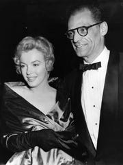 Arthur Miller and then-wife Marilyn Monroe attend Miller's