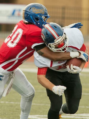 Kentucky team defensive back Davonte Robinson (Henry Clay) wraps up Louisville team wide receiver Clay Davis (CAL) at the 2015 Best of the Bluegrass All-Star Football Game at St. Xavier. 13 December 2015